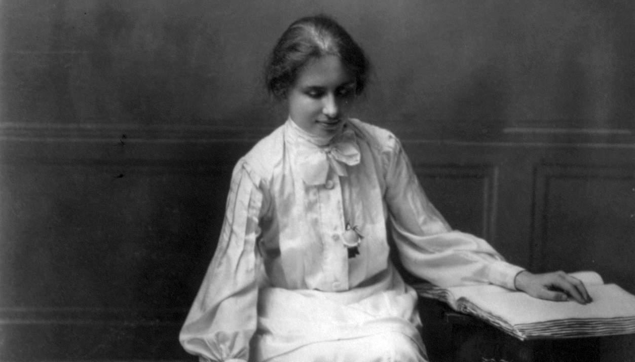 Hellen Keller reading brail
